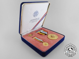 A Korean War Veterans Association Medal with Miniature & Case