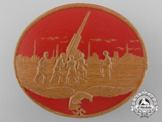 A Pressed Leather Luftschutz Badge