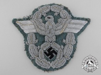 A German Police Officer's Bullion Sleeve Eagle; Uniform Removed
