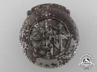 A Ground Recovered Dutch NSKK Badge
