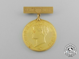 An 1899 Presidential Life Saving Medal in Gold to British Officer of S.S. Ivydene