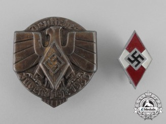 A Grouping of Two HJ Badges