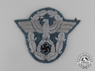 A Third Reich Period Police Officer's Bullion Sleeve Eagle