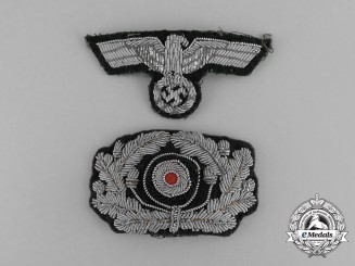 Two Wehrmacht Heer (Army) Visor Cap Insignia