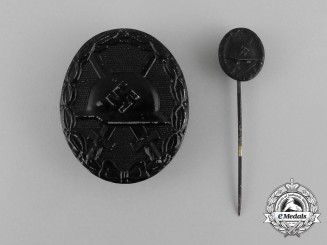 A Second War German Black Grade Wound Badge with Matching Stick Pin