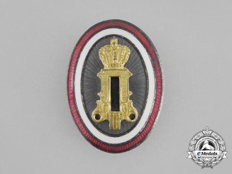 A Second War Serbian Officer's Cap Badge with Cypher of Peter II (1934-1945)