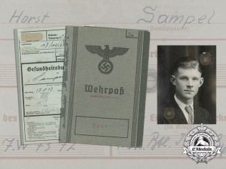 A Wehrpaß & Health Record to Wound Badge in Silver Recipient