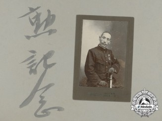 An Imperial Japanese Navy Officer's Studio Photograph
