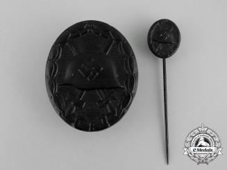 A Mint Second War German Black Grade Wound Badge with Matching Stick Pin