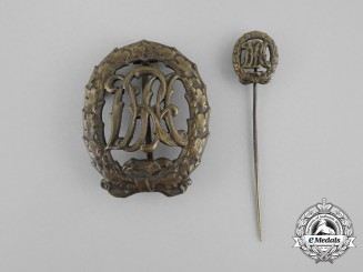 A Bronze Grade DRL Sports Badge with Matching Stick Pin by Wernstein of Jena