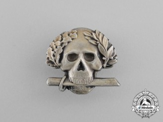A Second War Italian Black Brigade Skull Badge