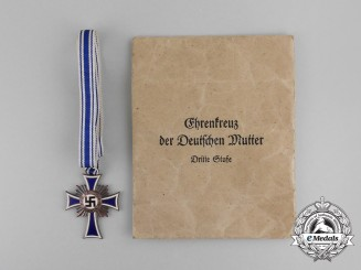 A German 3rd Class Cross of Honour of the German Mother with its Packet by Ernst & Müller