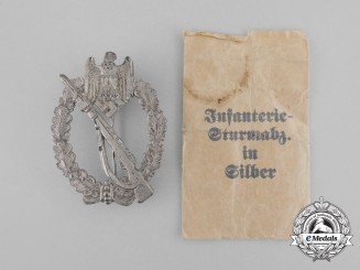 A Second War German Silver Grade Infantry Assault Badge in its Packet of Issue