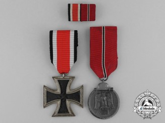 A German Medal Grouping Consisting of an Iron Cross 1939 & Eastern Front Medal