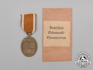A German Defence Wall (West Wall) Medal in its Packet of Issue by Friedrich Orth of Vienna