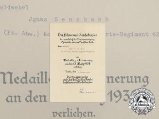 An Austrian Anschluss Medal Award Document to Wehrmacht Staff Sergeant