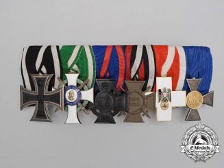A Fine Albert Order & Social Welfare Medal Bar
