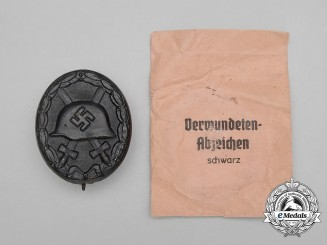 A Black Grade Wound Badge with Packet