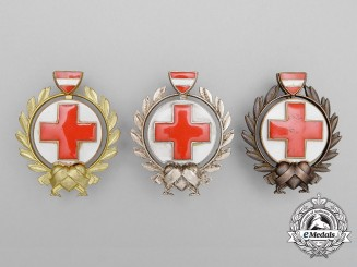 Three Austrian Red Cross Merit Breast Badges