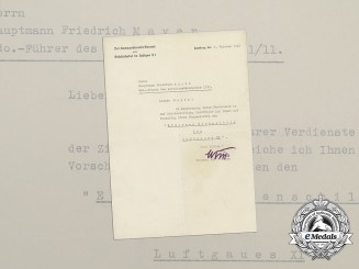 An Iron Honour Shield of Luftgau XI Award Document to Hauptmann Mayer