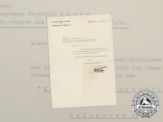 An Iron Honour Shield of Luftgau XI Award Document to Hauptmann Mayer