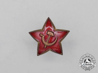 A Soviet Russian Red Army Private's Field Cap Badge