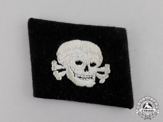 "Germany. A Waffen-SS ""Pumpkin Head Pattern"" EM/NCO's Totenkopf Collar Tab"