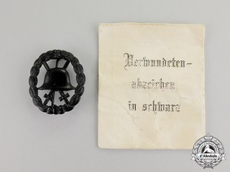 Germany. A Mint Imperial Black Grade Wound Badge in its Packet of Issue