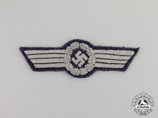 Germany. A Mint Luftwaffe Officer's Civil Fire Brigade Visor Cap Insignia