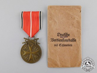 Germany. A Mint and Unissued Order of the German Eagle; Bronze Merit Medal with Swords