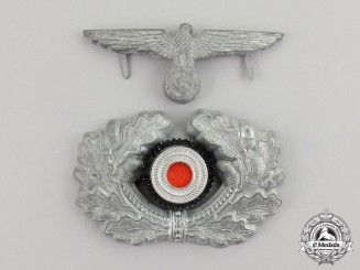 Germany. A Wehrmacht Heer (Army) Visor Cap Insignia Grouping
