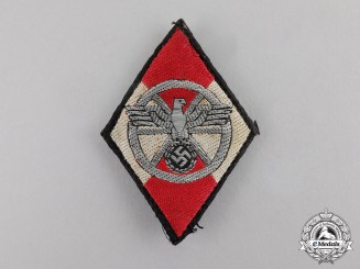 Germany. A NSKK Sleeve Diamond Insignia for Former HJ Members; Uniform Removed