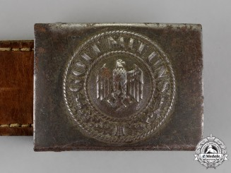Germany. A Wehrmacht Heer (Army) Standard Issue Belt Buckle with Tab, by E. Schneider, Dated 1941