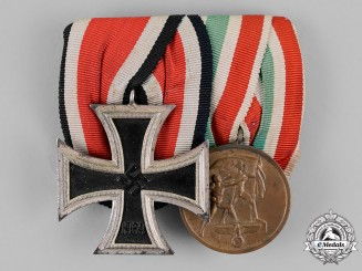 Germany. A Schinckel Iron Cross 1939 2nd Class & Memel Medal Pair