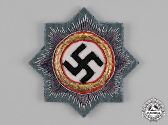 Germany. A Wehrmacht Heer (Army) Issue German Cross in Gold, by Westmann of Dresden