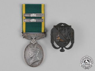 United Kingdom. An Efficiency Medal with Falkland Islands Scroll & Service Bars to Sergeant B. Fleuret