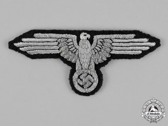 Germany. An RZM Type SS-Officer's Arm Eagle; Tunic Removed