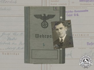 Germany, SS. A Wehrpaß and Preliminary SS ID Card to SS Totenkopf Unterscharführer Josef Chalupa