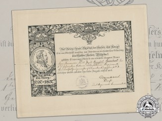 Germany, Imperial. An Emperor Wilhelm Centenary Medal Document to Gunner Reinhold Sprechert, Field Artillery, 1897