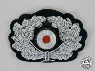Germany, Wehrmacht. An Officer's Visor Cap Wreath and Cockade, Bullion Version