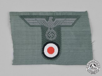 Germany, Wehrmacht. A Mint and Unissued Wehrmacht Heer (Army) Field Cap Insignia