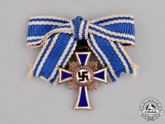 Germany. A Bronze Grade Mother's Cross; Miniature on a Ladies Ribbon