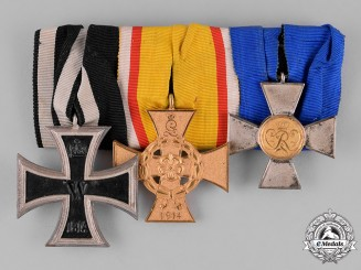 Lippe. A Prussia-Lippe Medal Bar with Three Medals, Awards, and Decorations