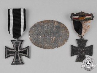 Prussia. A First War Period Identification Tag accompanied by Two Medals and Awards