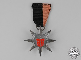 "Netherlands, Kingdom. A National Socialist Movement (NSB) ""Flower Bulbs"" March Badge 1943"