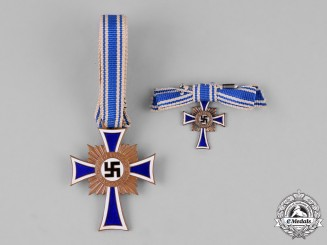 Germany. A  Cross of Honour of the German Mother, Bronze Grade, with its Miniature