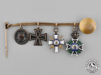 Saxony, Kingdom. A Boutonniere Chain with Four Medals, Awards, and Decorations