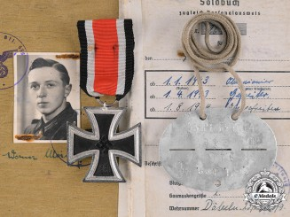 Germany. An Iron Cross, Identification Tag, and Soldbuch to Werner Meining