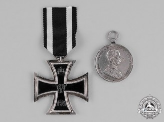 Austria and Germany, Imperial. A Grouping of a Silver Austrian Bravery Medal, Second Class, and a 1914 Iron Cross, Second Class
