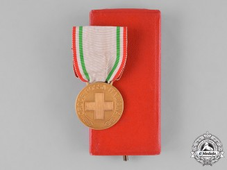Italy, Kingdom. An Extremely Rare Red Cross Merit Medal in Gold